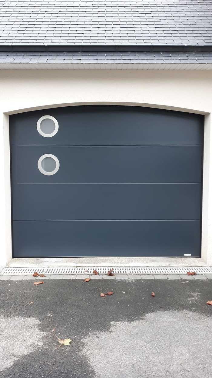 Installation porte de garage ouverture sectionnelle latérale 0